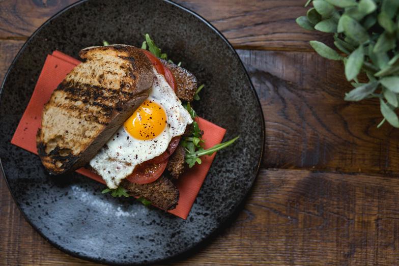 crispy-sujuk-on-sourdough-dill-mayo-tomato-fried-egg