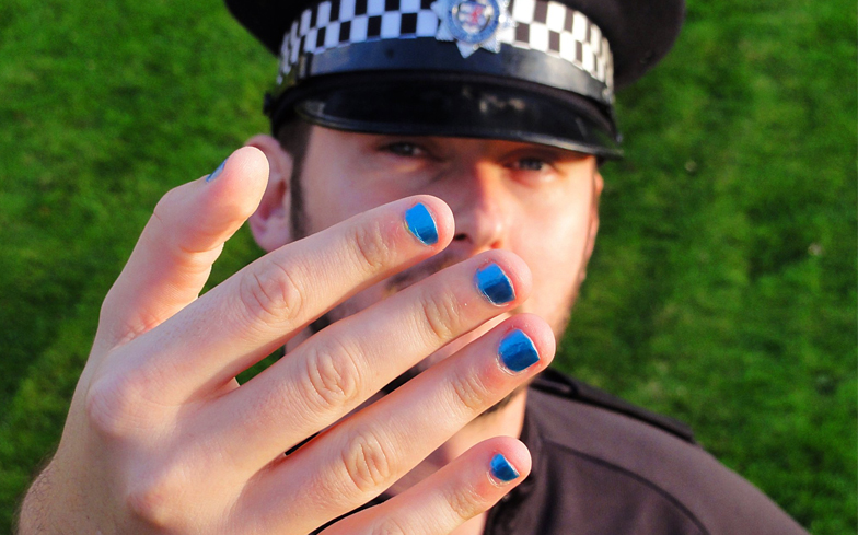 Male police officers criticised for painting their nails to ...